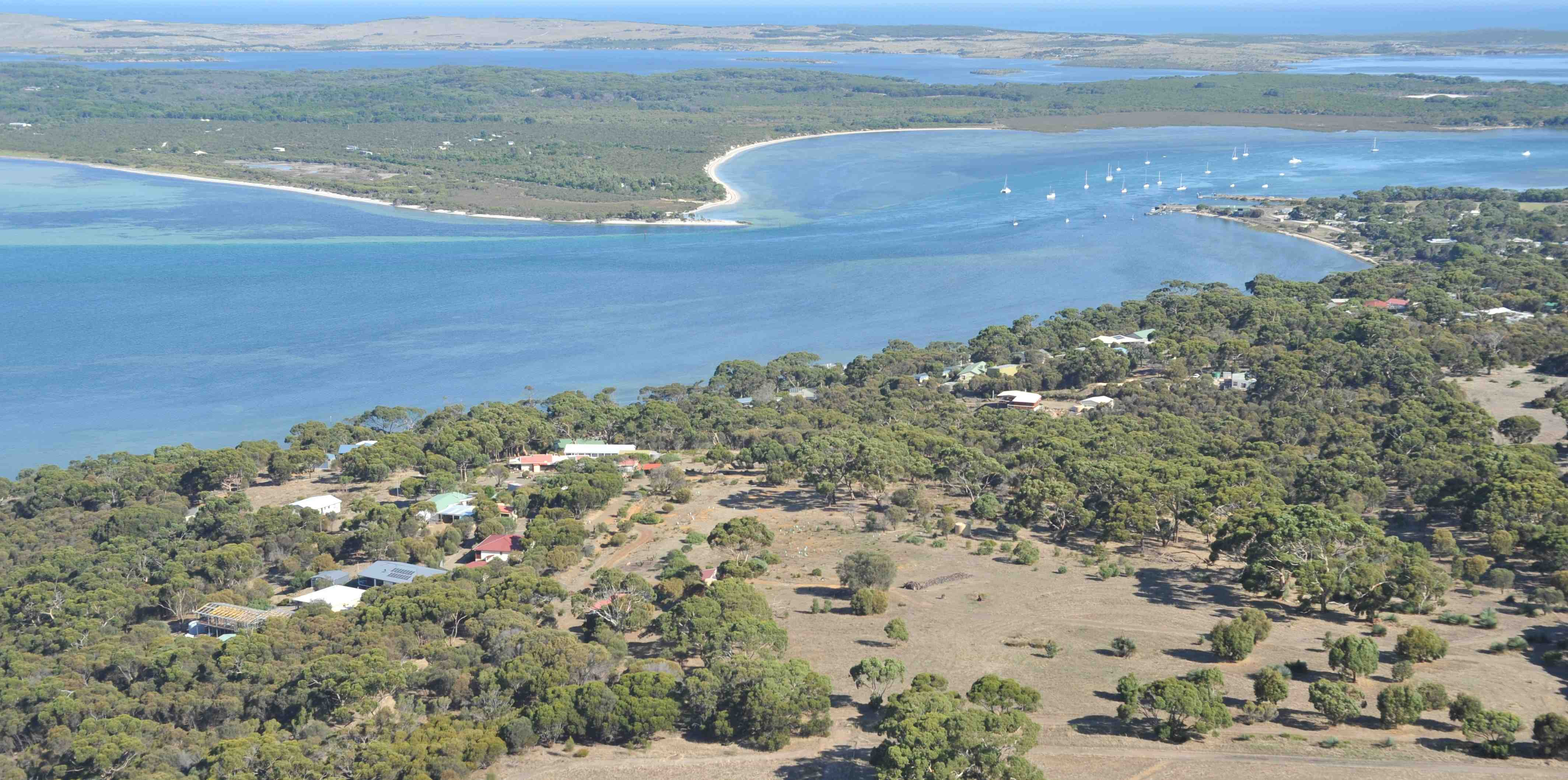 Aerial view on Buddhâyatana and Pelican Lagoon, with the Southern Ocean at the horizon